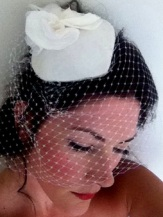 Light ivories and whites, silk hat with birdcage veil.