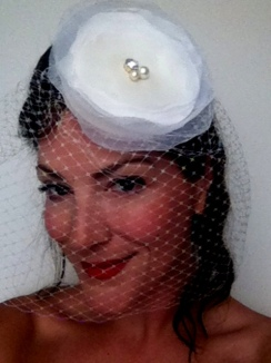 French net, playful birdcage with multi layered silk and organza flower.Rhinestone and pearls on top.