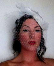 Feathers and sequins adorn this glam birdcage veil. See BRIDES gallery for more.