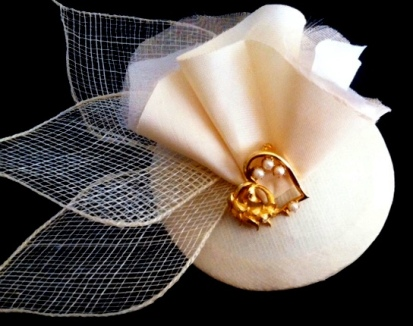 Heart of Gold- pearls, silk and sinamay play on this dark ivory raw silk, round base