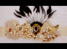 1920's beaded sash with vintage pendant and black feathers.