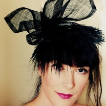 White silk base covered with black lace and a black feather fringe.