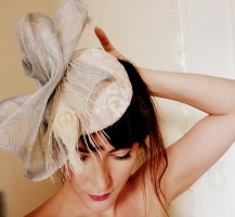 Lace covered silk base. Silver and cream race hat.