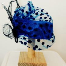 Blue and black polka dot hat with black sinamay and butterfly