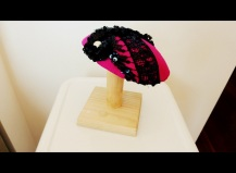 Black sequins, fuschia silk, and a giant pearl cocktail hat.