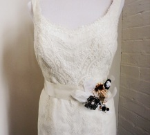 Pearls, gold butterflies, white feathers, black florette