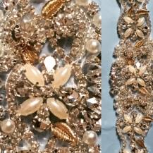 Gold leaves, crystals, pearls and satin sash.